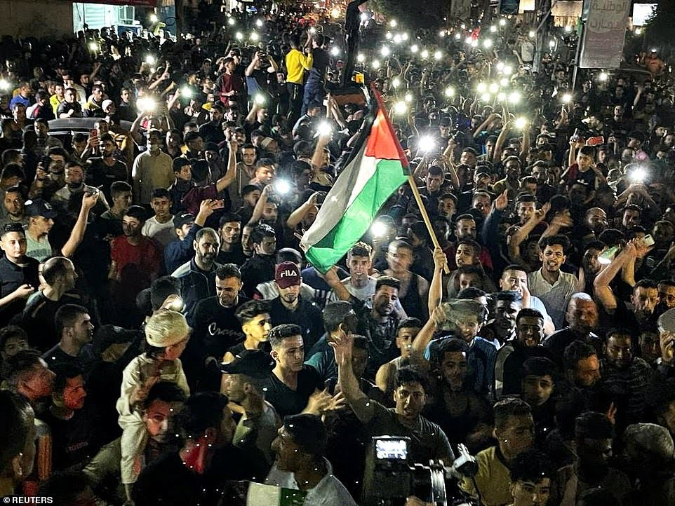 Celebrations in the street as Israel and Hamas CEASE FIRE