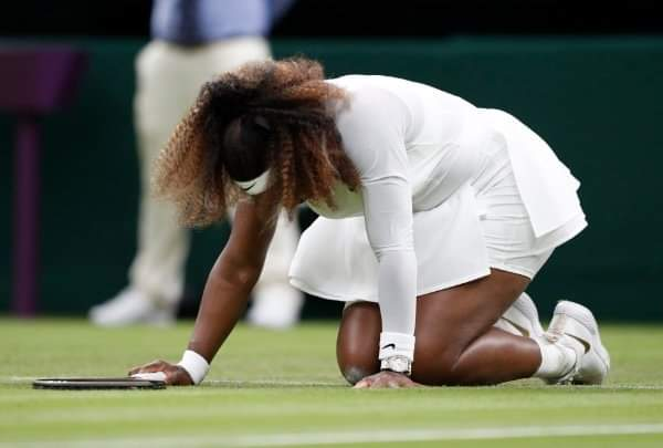 Serena retires from Wimbledon after injuring knee on slippery court