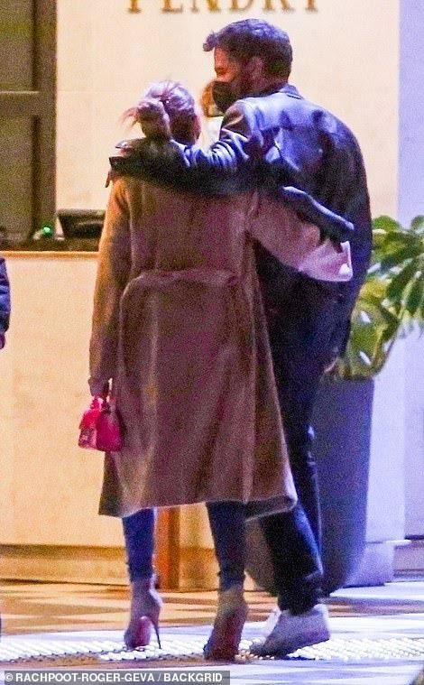 ennifer Lopez and Ben Affleck can't keep their hands off each other